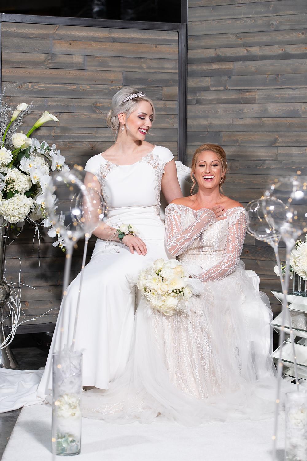Models displaying wedding dresses amid wedding decor