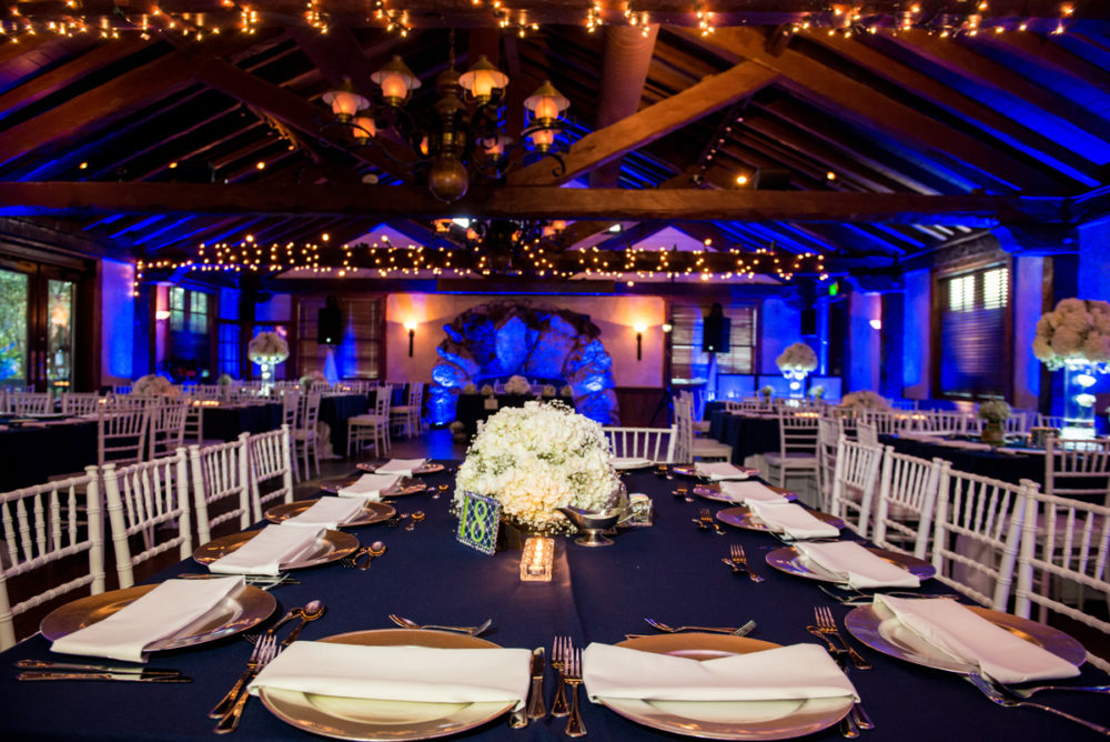 Indoor wedding reception Dubsdread Ballroom dramatic blue uplighting
