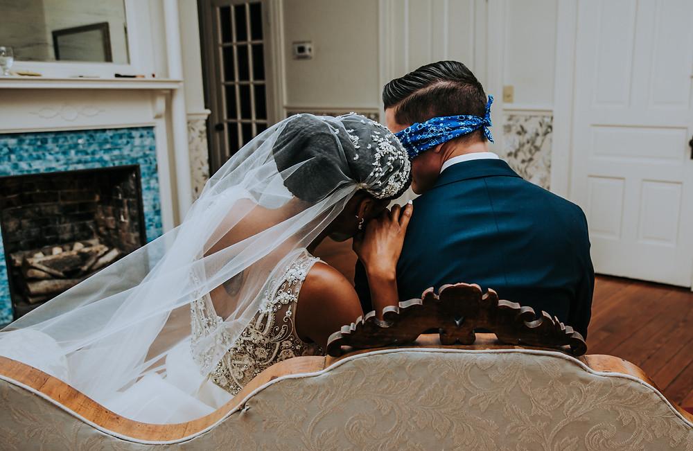 groom blindfolded meeting bride before wedding
