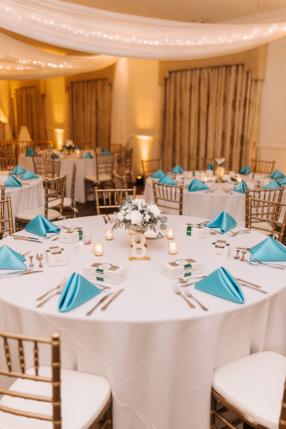 Wedding table decor with turquoise napkin and donut favors