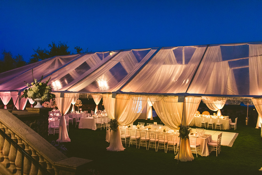 Wedding tent with chandeliers chairs and dance floor