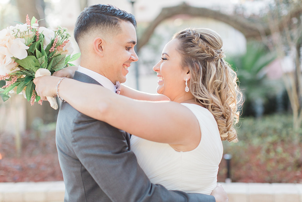 Bride and groom picture in courtyard at Dr Phillips House