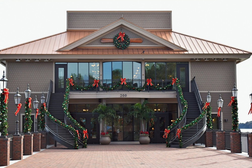 Exterior view from the dock at Tavares Pavilion on the Lake decorated for Christmas