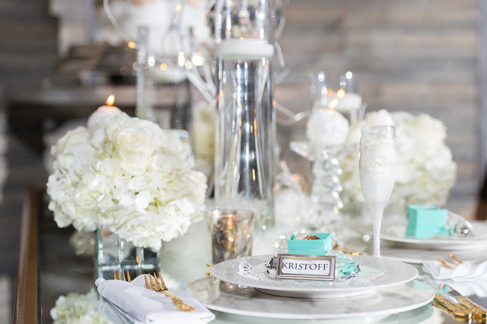 Frozen-inspired table setting with floral and decor