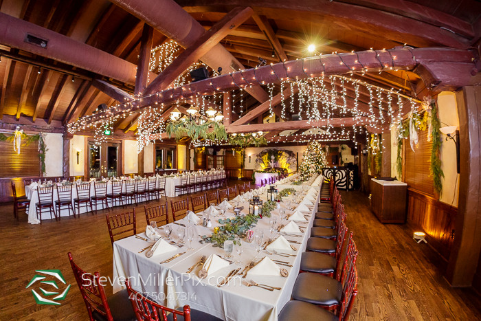 Indoor wedding reception Dubsdread Ballroom hanging lights and floral