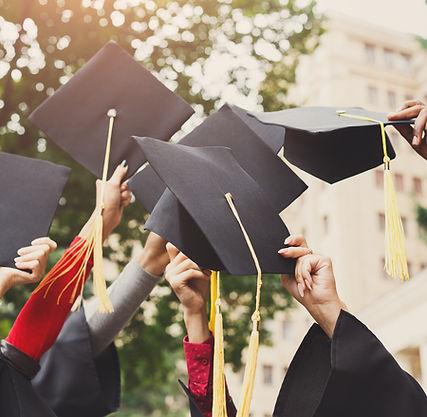 a-group-of-graduates-throwing-graduation