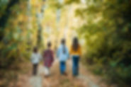A group of four children in the autumn f