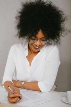 woman-in-white-dress-shirt-wearing-eyegl