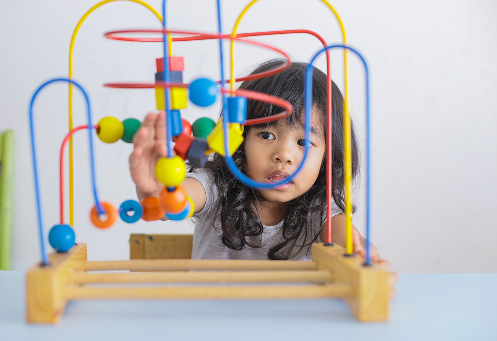 Girl with Autism playing