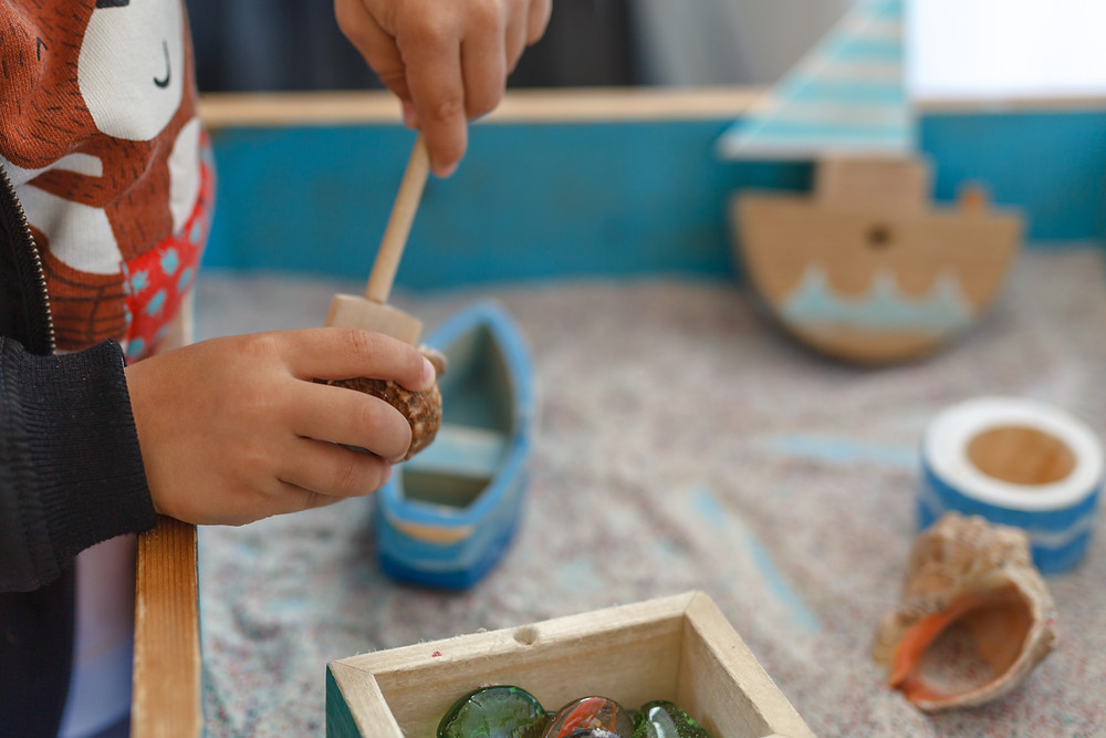 Play therapy - child playing in sand tray