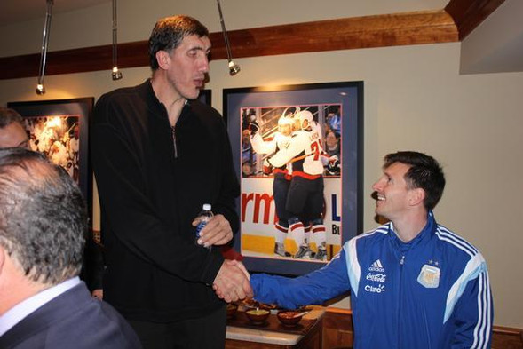Gheorghe Muresan and Lionel Messi