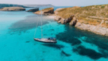 Aerial-of-Yacht-in-Blue-Lagoon-off-Comin