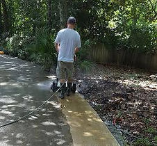 Pressure washing driveway by Northwest Florida Pressure Washing in Fort walton beach, FL