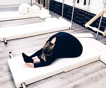 Sharon head on knees