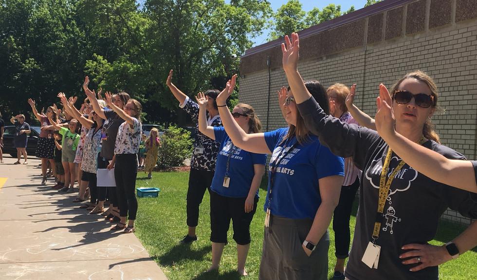 teachers waving.jpg