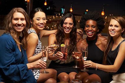 Portrait Of Female Friends Enjoying Nigh