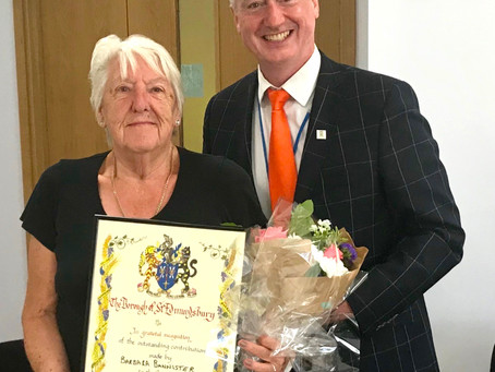Paul presents Newbury Community Centre Chair, Barbara Bannister with an Award