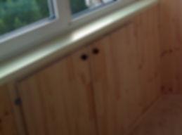 Шкаф под балконной рамой