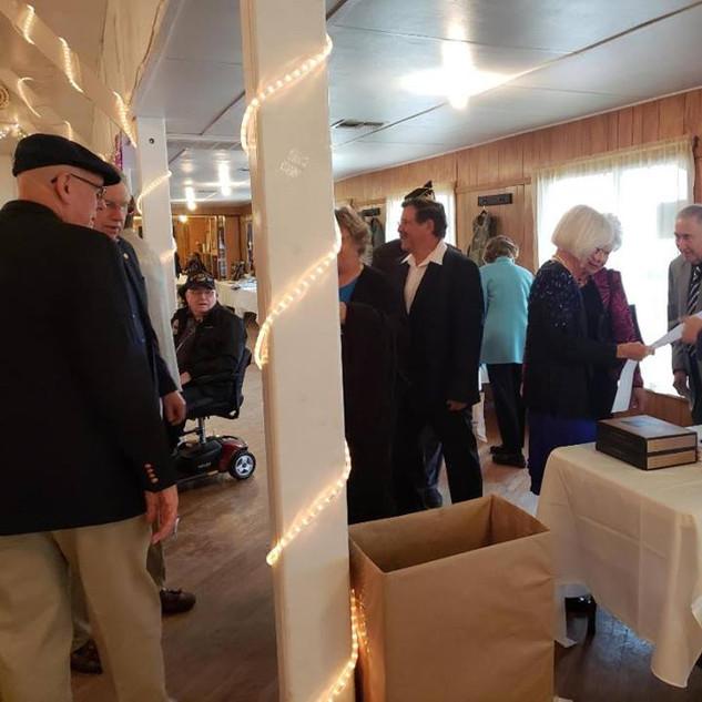 John Nye and Linda Nye greeting guests