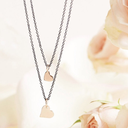 Double heart necklace by Mabel Chong