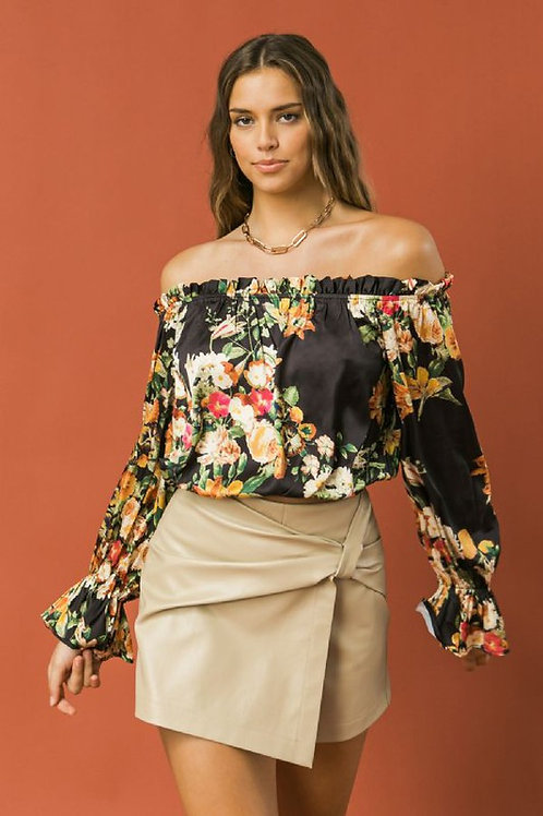 Satin printed top featuring off shoulder neckline with mini ruffled edge