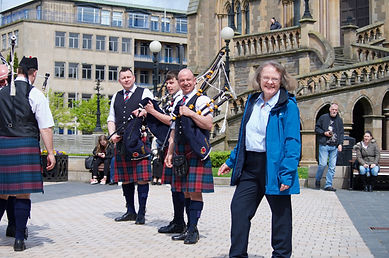 Fiona Mackenzie Tourist Guide with pipers outside the McManus Museum and Art Gallery, Dundee
