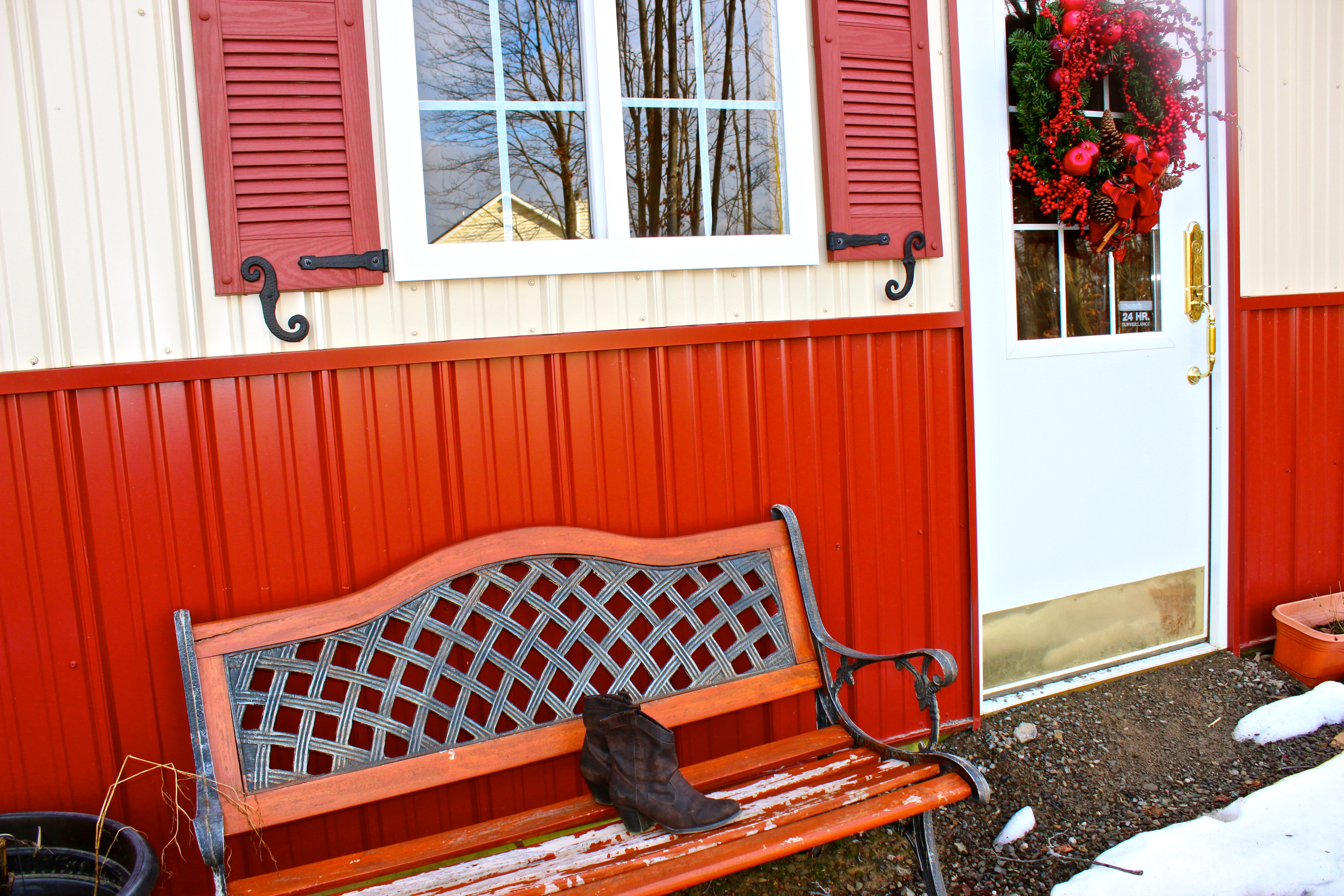 Bench in front of barn.