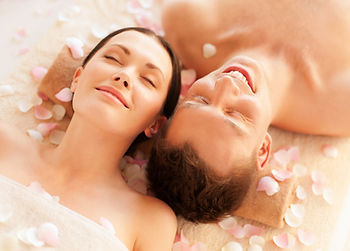 picture of couple in spa salon lying on