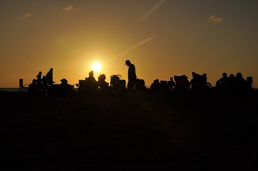 Sunset on the beach with the telescope ready