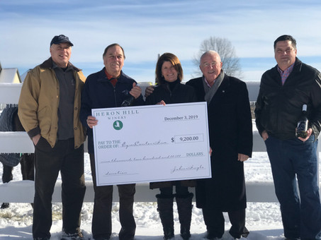 EquiCenter receives generous donation from Heron Hill Winery on Giving Tuesday.