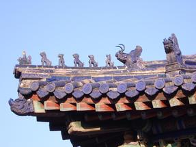 Háztetőkön időző oroszlánok a Császári palotába, szintén Pekingben.
