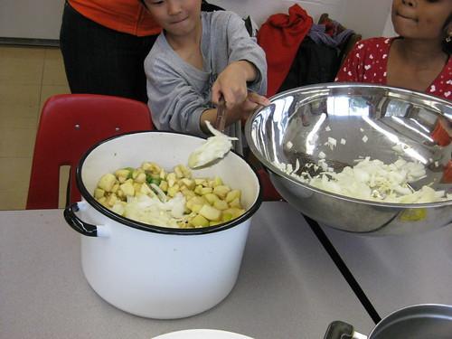 adding onions & garlic to pot!