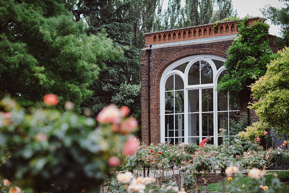 The Orangery in Holland Park view from rose garden