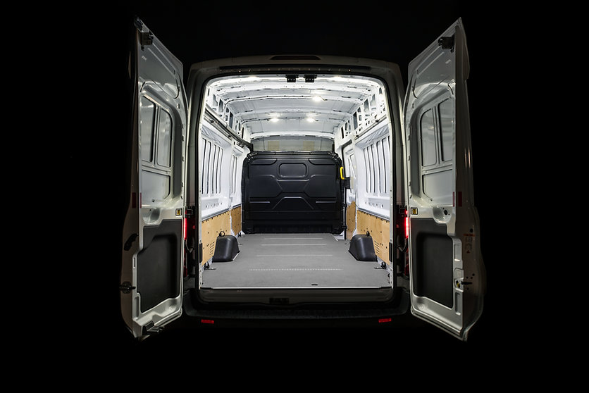 Empty van with open doors an light inside Empty van.jpg