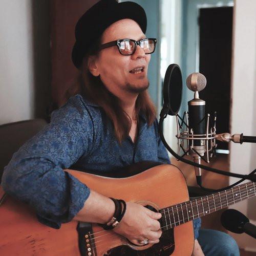 Kirk Adams, singing in the Song Divers Studio.
