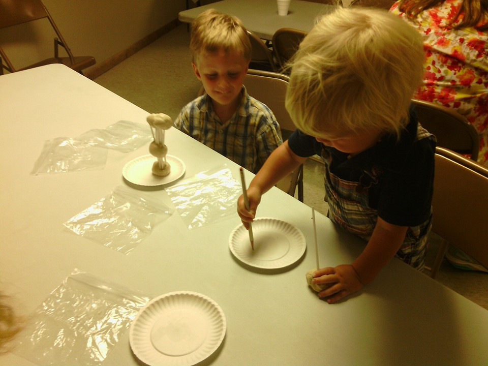 Young visitors enjoying our Make-and-Take clay station