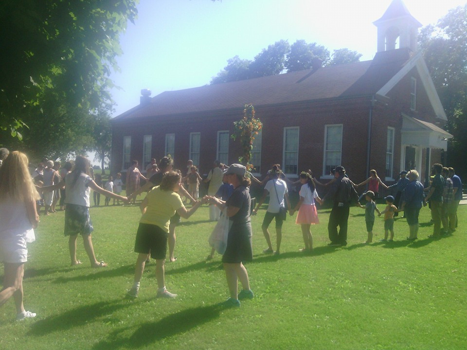 Dancing around the Maypole outside the Colony School