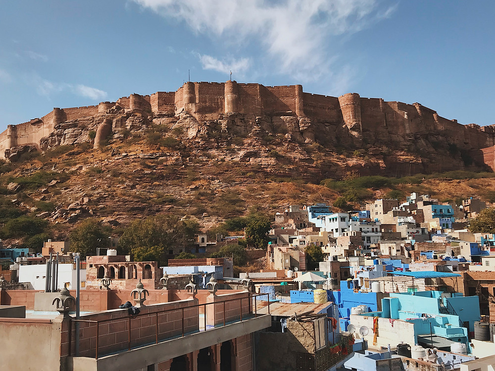 The view of Mehrangarh Fort dominating the skyline of the Blue City of Jodhpur, Rajasthan, India