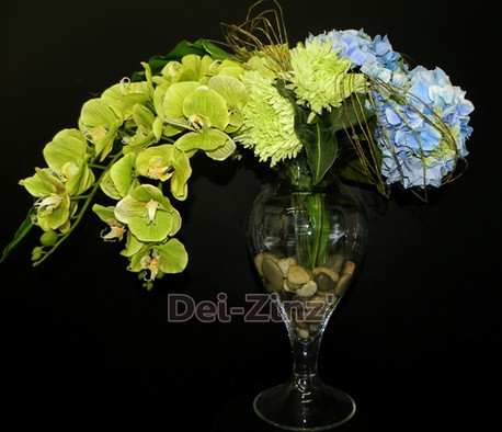orchids and hydrangeas in clear glass