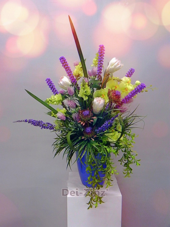colorful mixed bouquet in blue vase