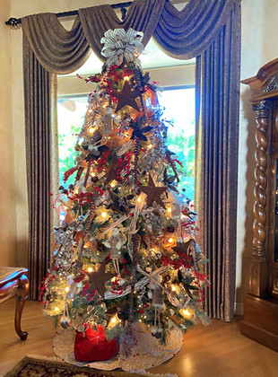 heavily decorated tree with a country to