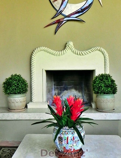 patio-fireplace-with-boxwood-and-bromeli