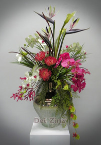 orchids strelitzia and protea arrangement