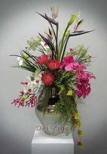 orchids strelitzia and protea arrangement