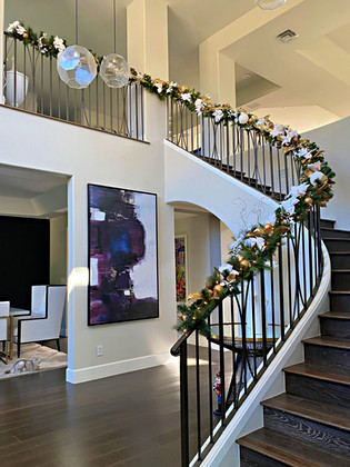 gold and white decorated stair rail garl