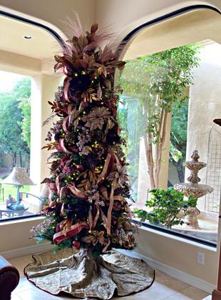 slim artificial Christmas tree in bronze