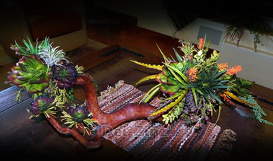 faux succulent arrangement on manzanita