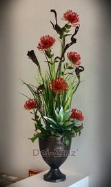 mixed faux arrangement with red pincushion protea