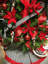 red and black ornaments with matching tr