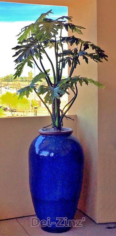 faux-philodendorn-selloum-plant-on-balcony